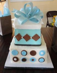 image of a blue and brown present cake for a boy baby shower