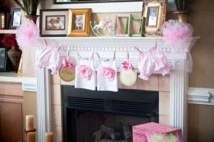 How to host the cutest preppy and pink baby shower for Baby clothesline decoration
