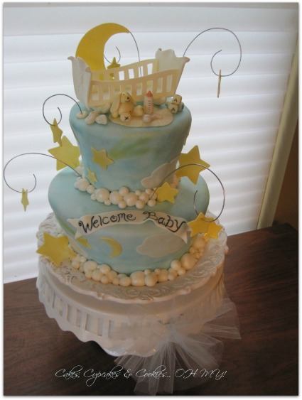 image of a DIY moon and stars baby shower cake