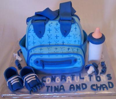 Picture of a blue baby shower diaper bag cake