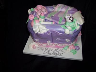 picture of a purple diaper bag cake