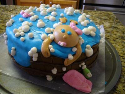 picture of a blue baby bathtub cake