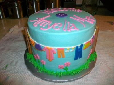 picture of blue baby clothesline cake