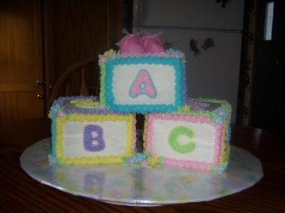 picture of blocks and booties baby shower cake