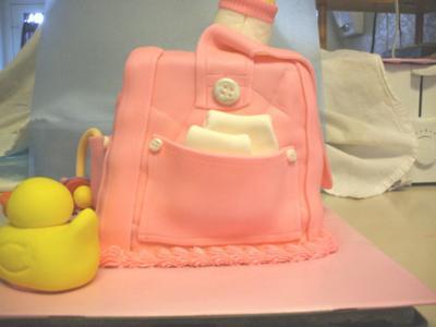 cute picture of a pink diaper bag cake