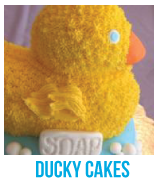 banner of ducky baby shower cakes