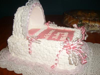 picture of a pink and white baby bassinet cake