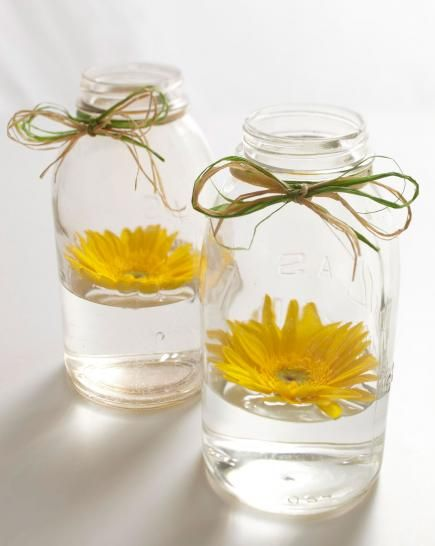 image of mason jar and a yellow flower