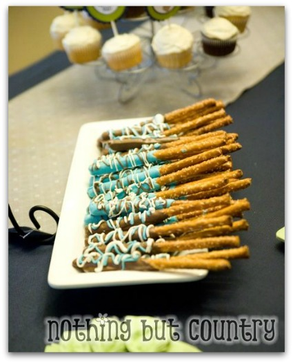image of blue chocolate baby shower pretzels for a boy baby shower