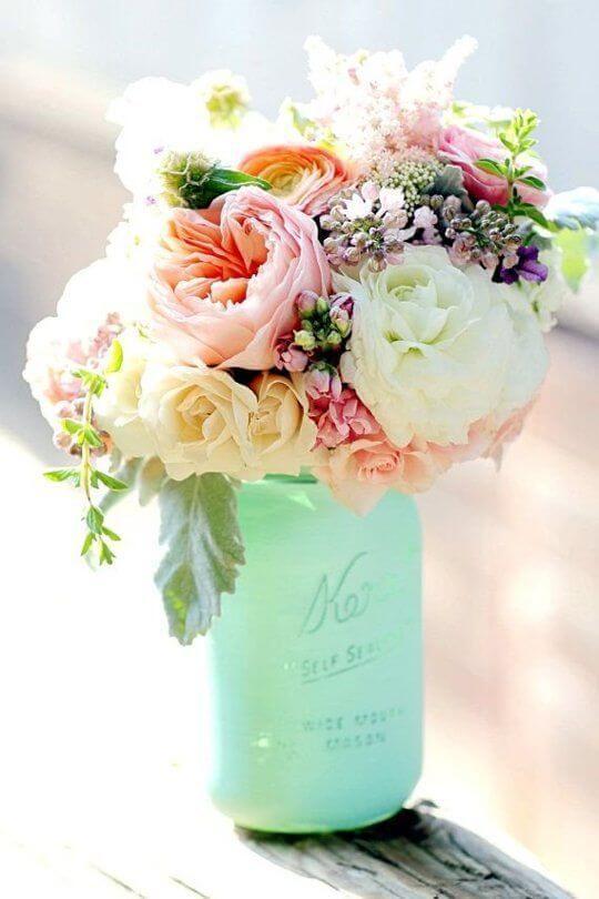 image of mason jar baby shower flower arrangement