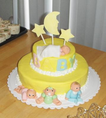 picture of a yellow moon and stars baby shower cake