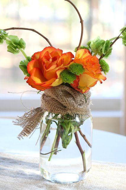 image of baby shower flower arrangement in a mason jar