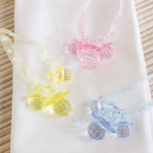 plastic pacifiers for the Don't Say Baby baby shower game