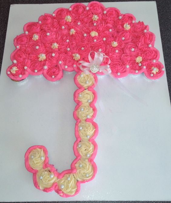 image of pink umbrella baby shower pull apart cake
