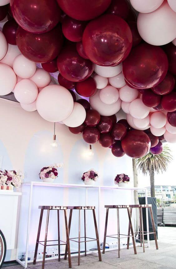red and pink balloon garland