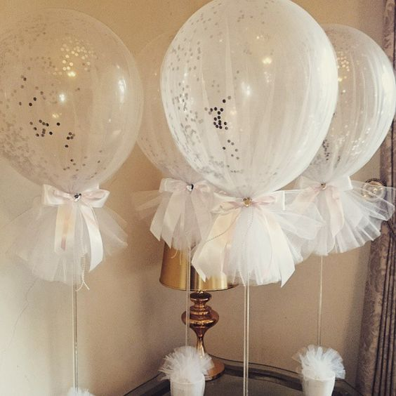 image of white tulle covered baby shower balloons