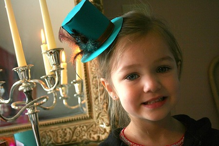 picture of girl wearing alice in wonderland party hat
