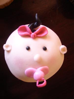picture of pink baby face cupcakes for a girl