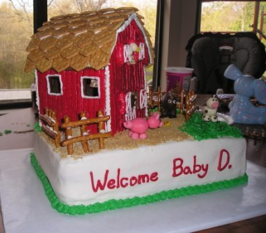 image of a farm animal barn baby shower cake