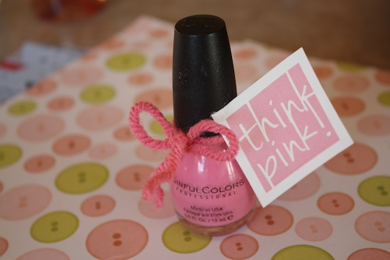 pink nail polish with a favor tag
