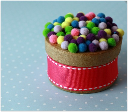 picture of cute pom pom favor boxes