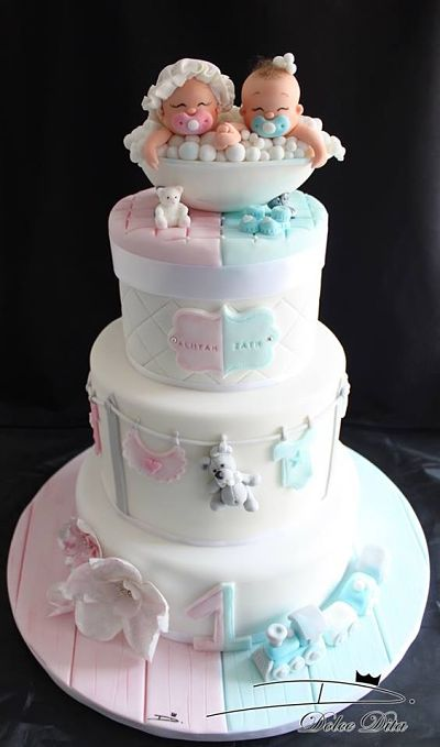 Banner Of A Pink And Blue Baby Shower Cake For Twins