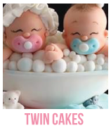 banner of twin baby shower cakes and cupcakes