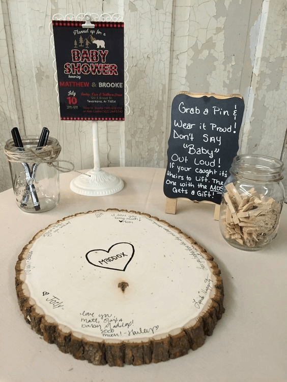 Log guestbook for a woodland baby shower