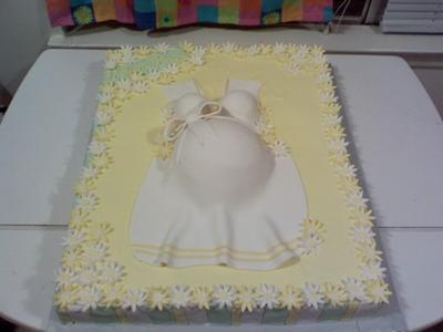 picture of a yellow pregnant belly baby shower cake