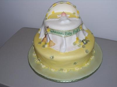 picture of a yellow baby bassinet cake